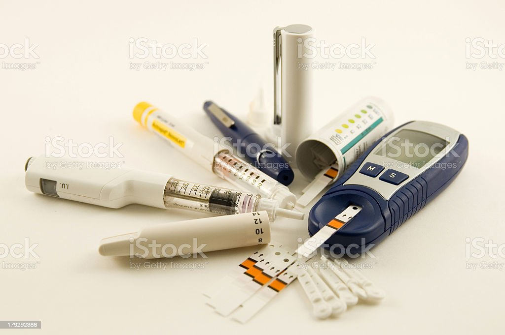 Diabetic medication supplies laid out on white background stock photo