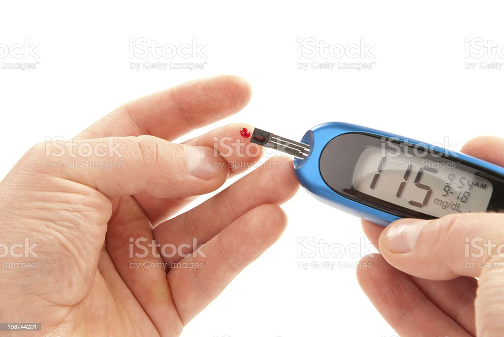Diabetic patient doing glucose level blood test royalty-free stock photo