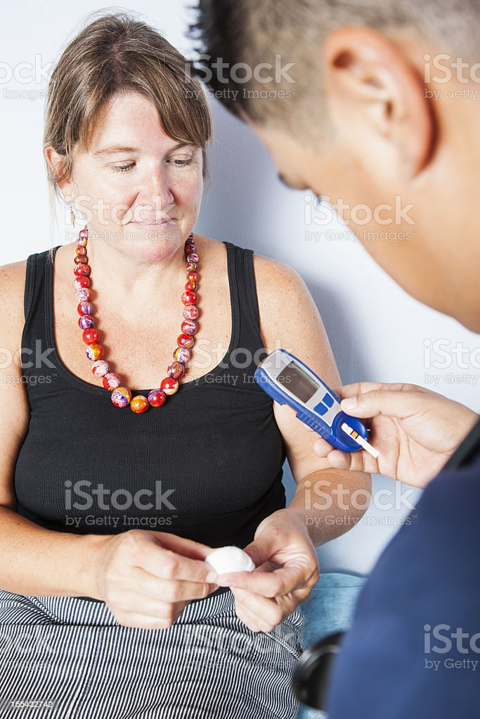 Diabetic patient with her doctor stock photo
