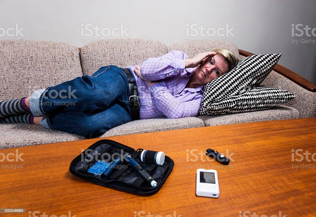 Diabetic person experiencing hypoglycaemia or a sugar crash. stock photo