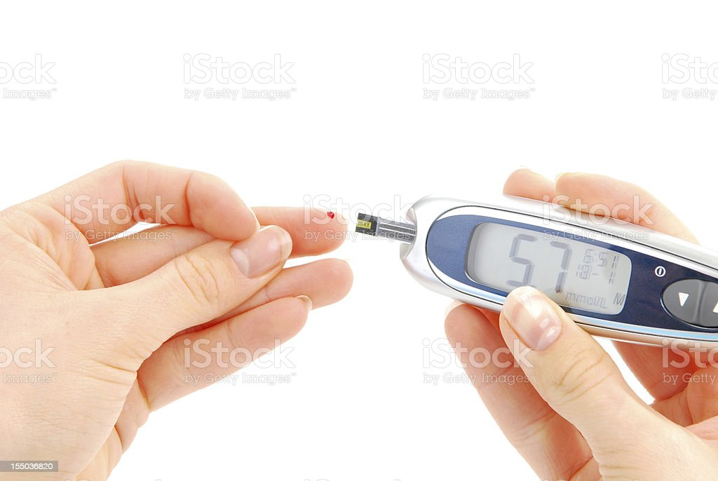 Diabetic person performing a glucose level blood test royalty-free stock photo