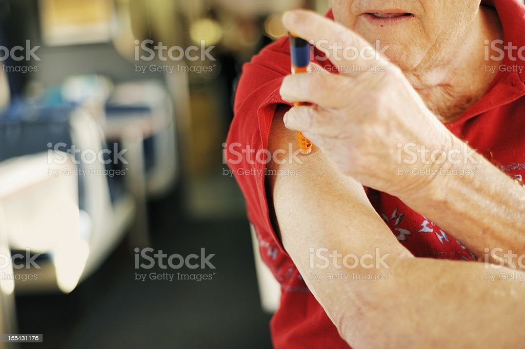 Diabetic Senior Man Self-Injects Insulin stock photo
