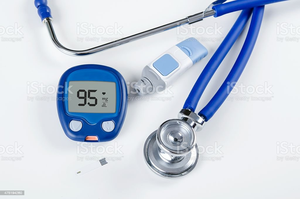 Diabetic test kit and stethoscope on white background stock photo