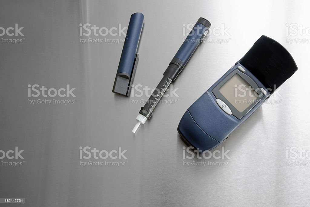 Diabetic testing and insulin injection devices stock photo