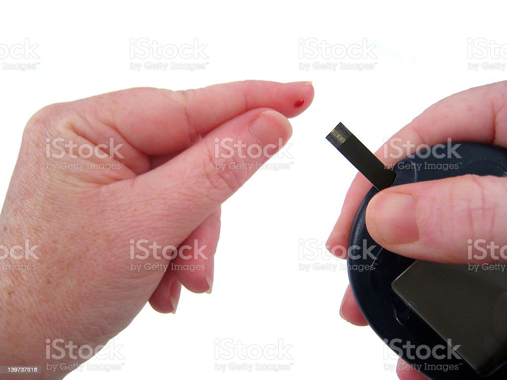 Diabetic Uses Glucometer royalty-free stock photo