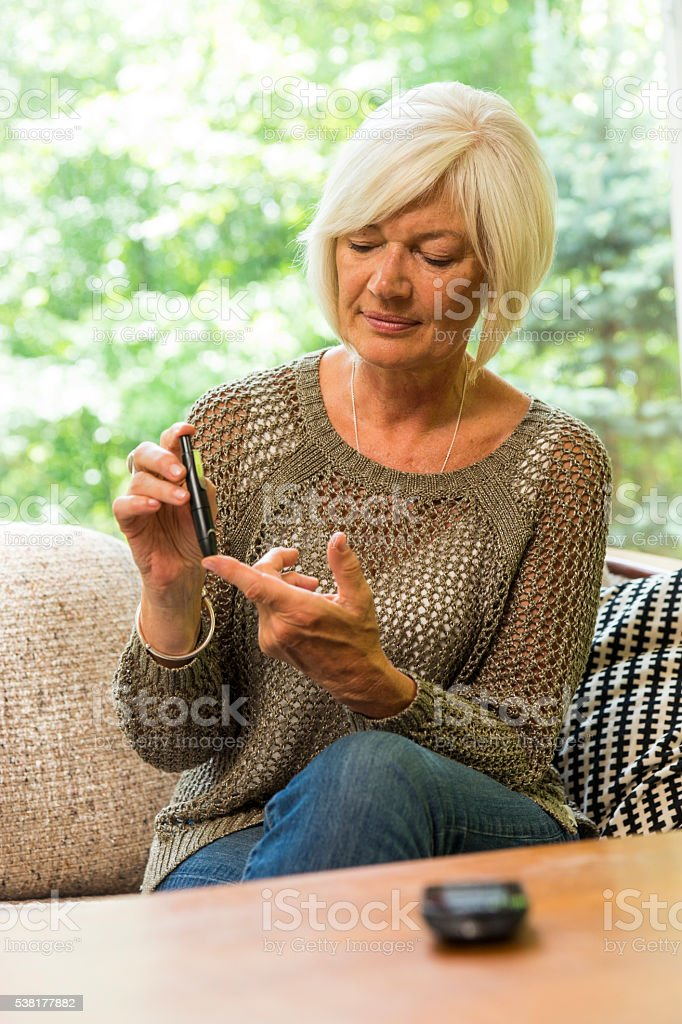 Diabetic woman in her sixties stock photo