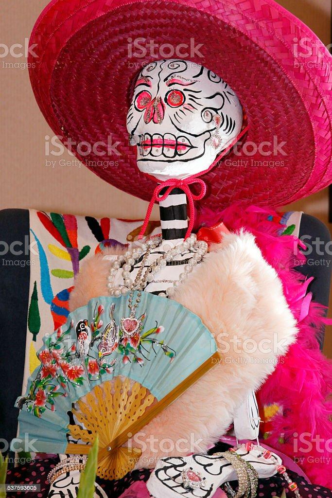 Dia-De-Los Muertos Day-of-the-Dead Bright Colors Skull Skeleton Doll Decoration Figurine stock photo