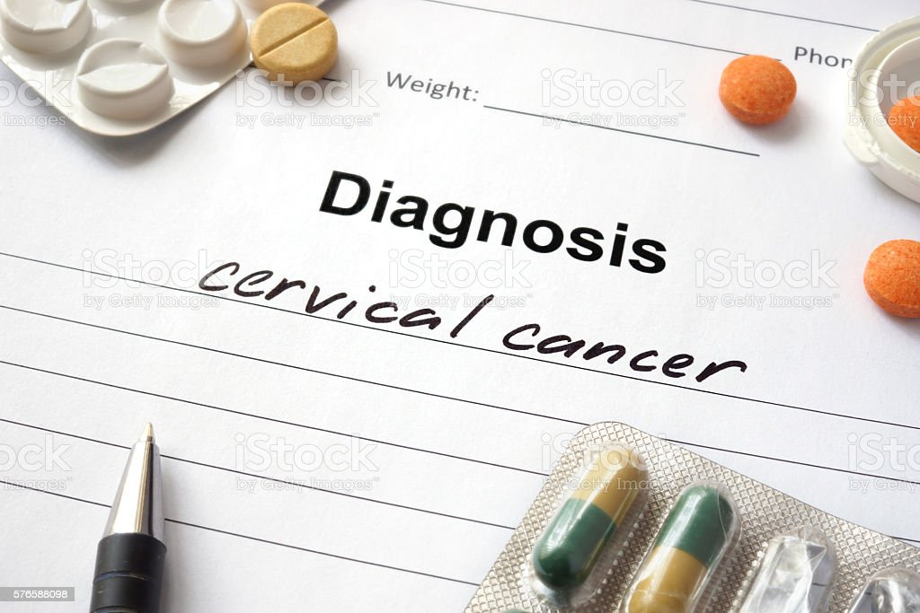 Diagnosis cervical cancer written in the diagnostic form and pills. stock photo