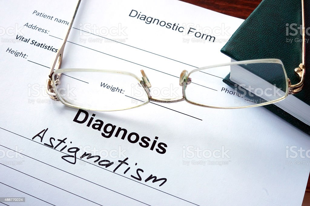 Diagnosis list with Astigmatism and glasses. Eye disorder concept. stock photo
