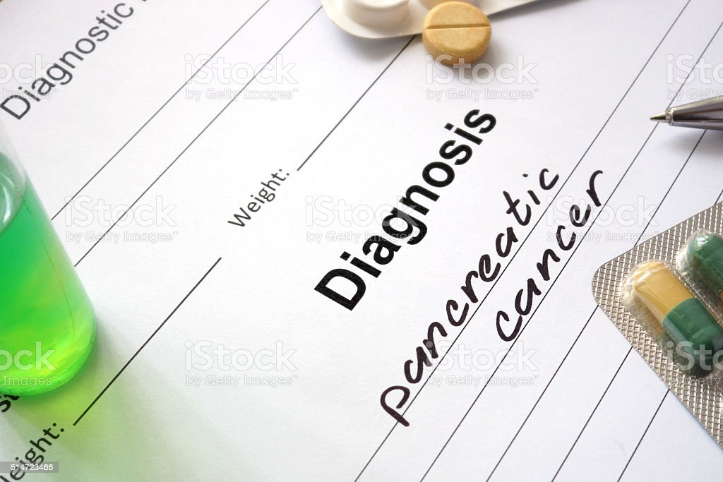 Diagnosis pancreatic cancer written in the diagnostic form and pills. stock photo