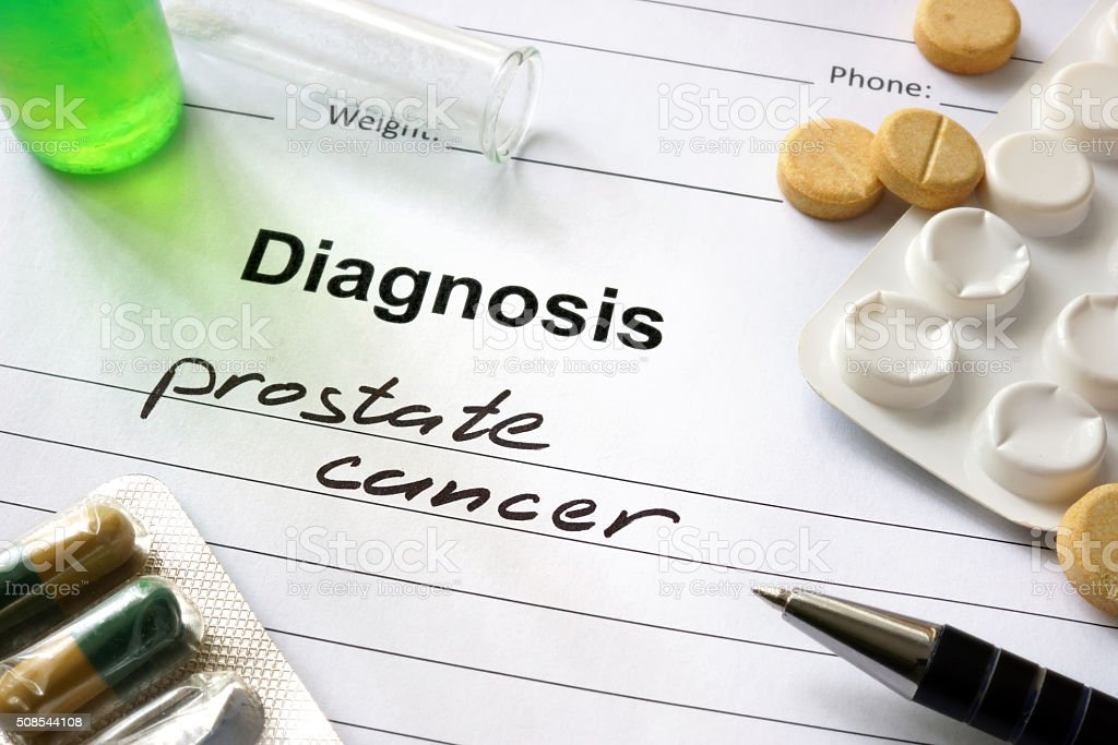 Diagnosis prostate cancer written in the diagnostic form and pills. stock photo