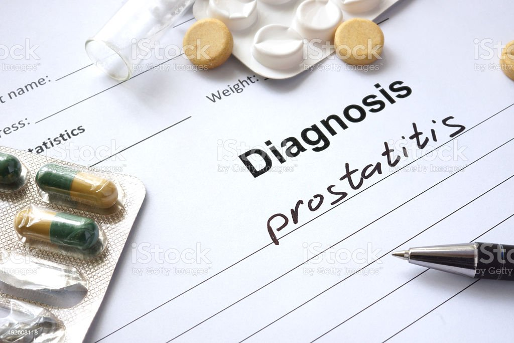 Diagnosis prostatitis written in the diagnostic form and pills. stock photo