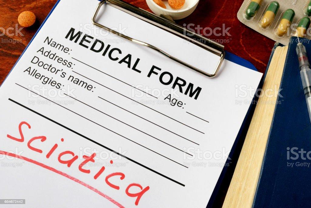 Diagnosis sciatica written in a medical form. stock photo