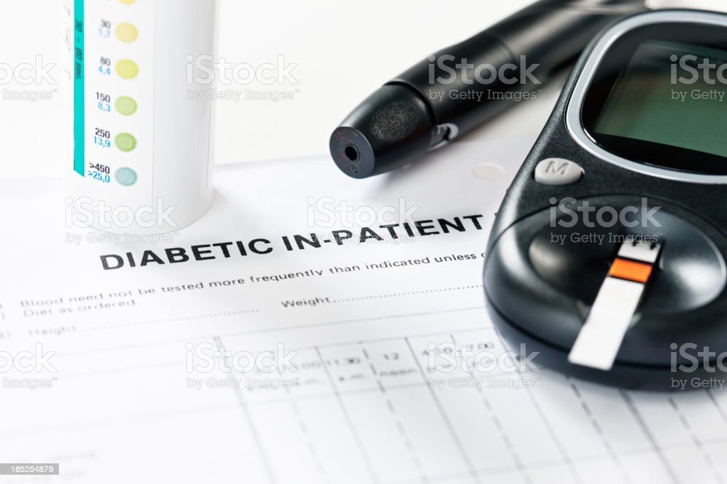 Diagnostic equipment for diabetics: glucometer test strips and automatic lancet stock photo