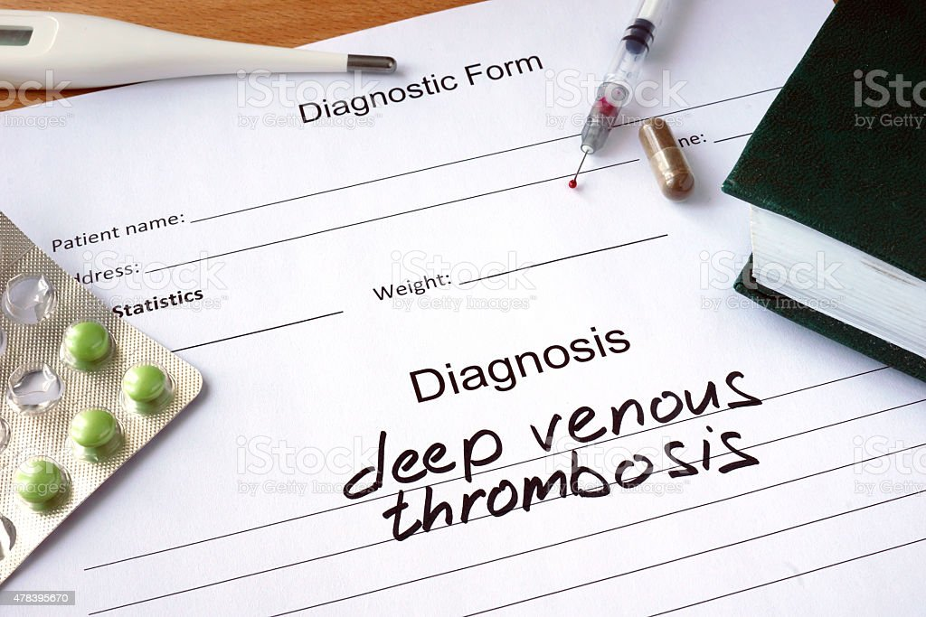 Diagnostic form with Diagnosis deep venous thrombosis  and pills. stock photo