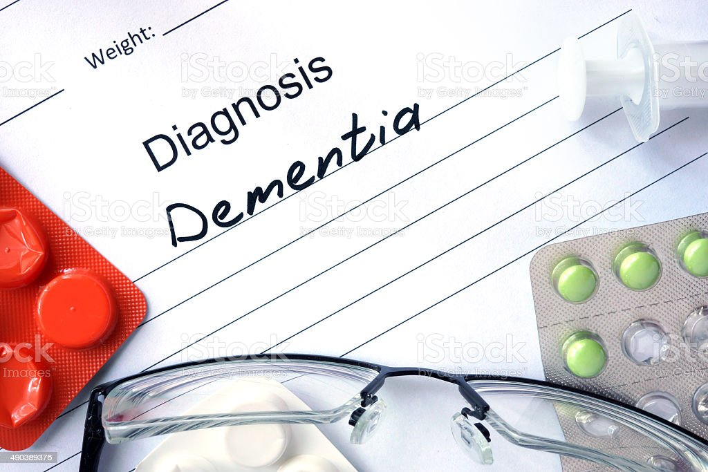 Diagnostic form with Diagnosis dementia and pills. stock photo