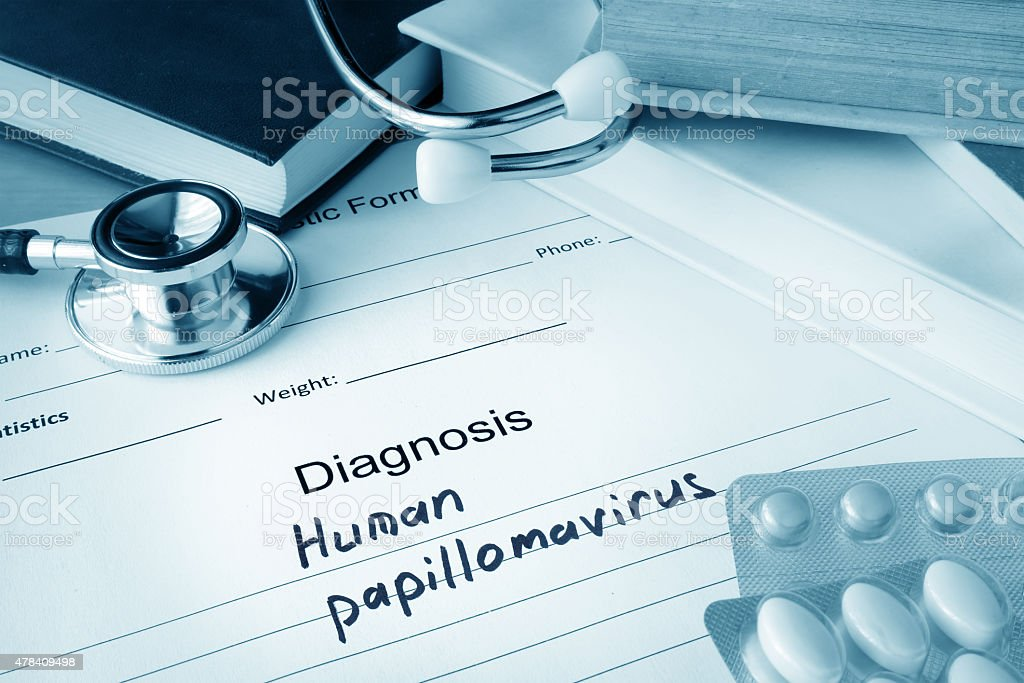 Diagnostic form with diagnosis Human papillomavirus HPV and pills. stock photo