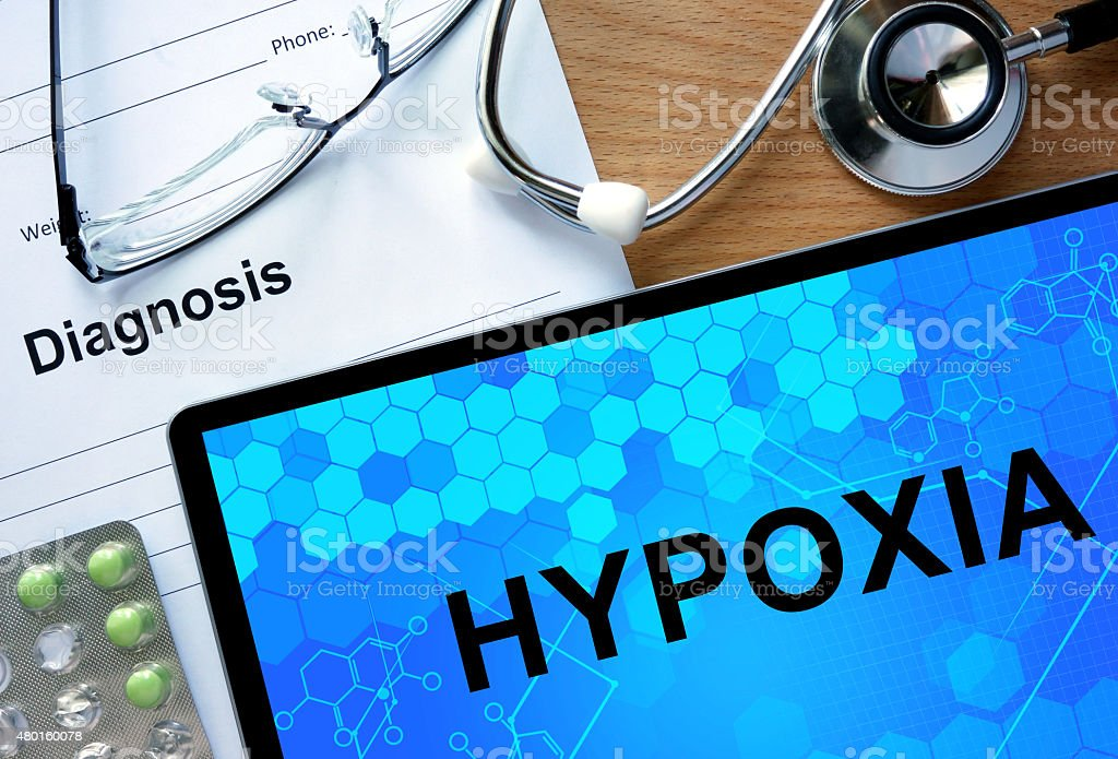 Diagnostic form with diagnosis Hypoxia and pills. stock photo