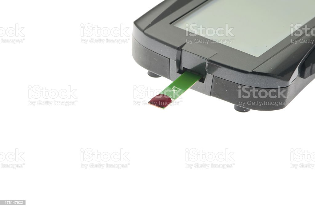 diagonal glucometer with test strip an blood drop stock photo