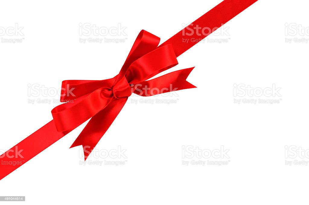 Diagonal red gift bow and ribbon isolated on white background stock photo