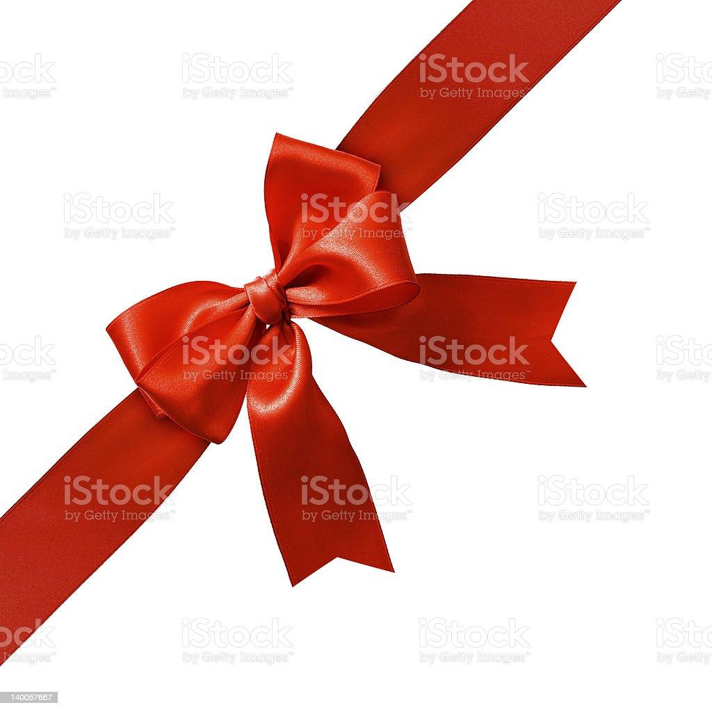 Diagonal red satin gift bow across stark white background stock photo