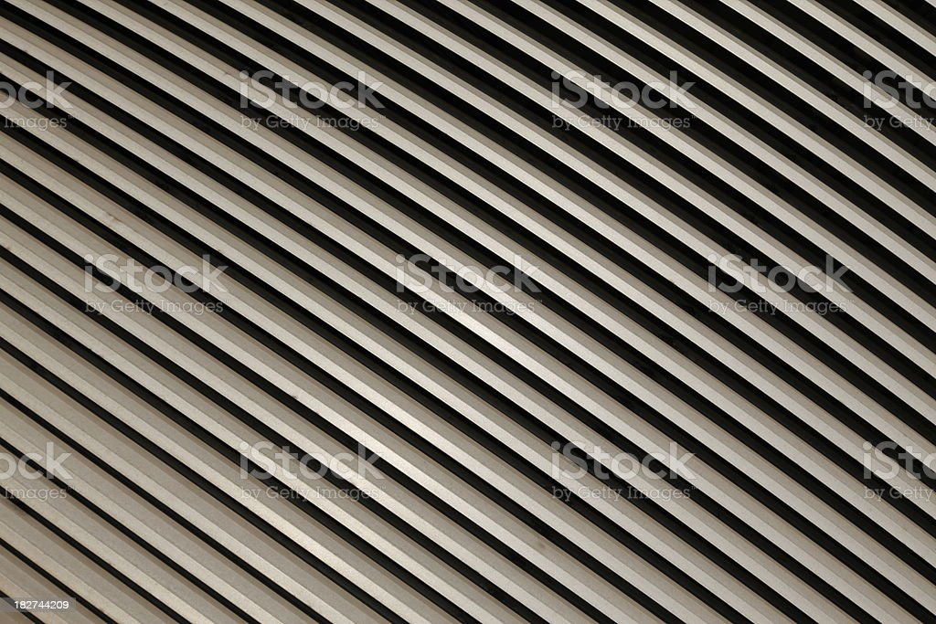 Diagonal stainless steel slats in line background royalty-free stock photo