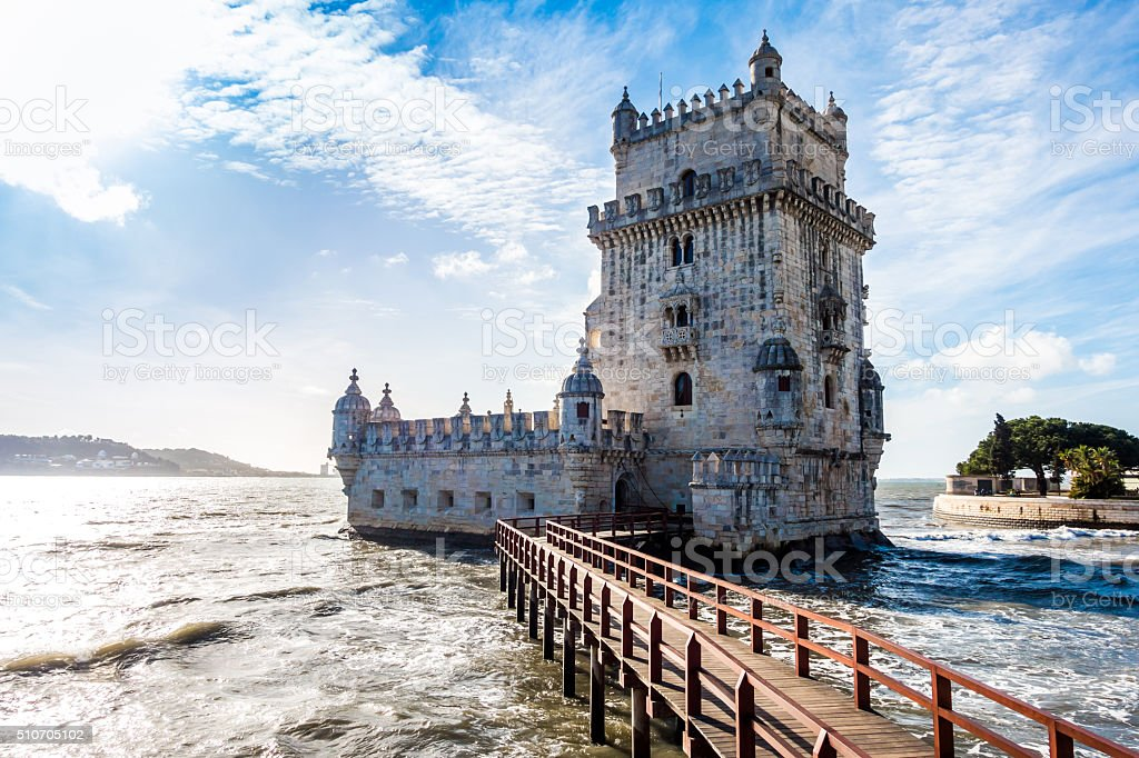 diagonal torre belem tower lisboa lisbon sun flare clouds stock photo
