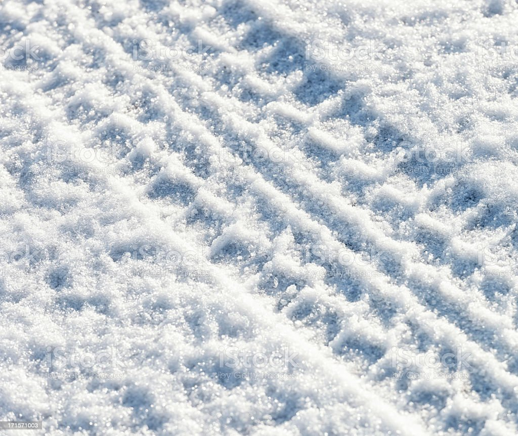 Diagonal Tyre Track in Snow royalty-free stock photo
