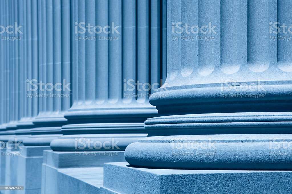 Diagonal view of large blue columns stock photo