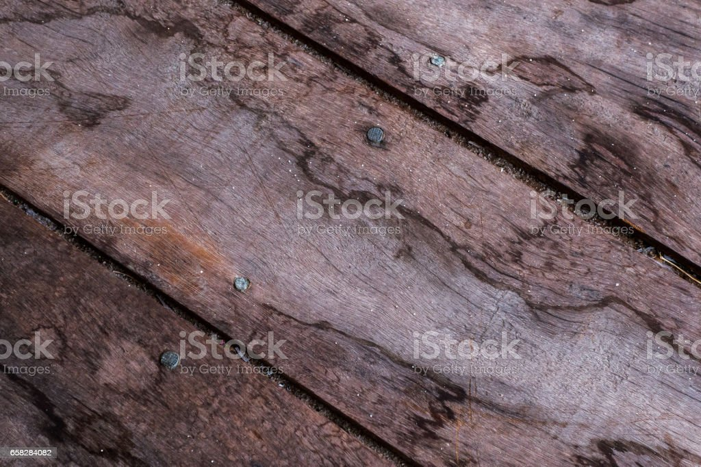 Diagonal wooden floorboards with grains of sand stock photo