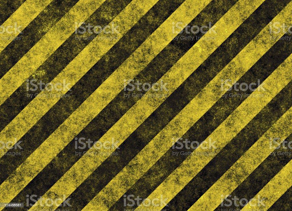 Diagonal yellow and black hazard stripes stock photo