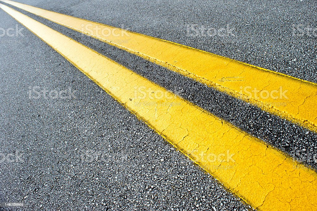 Diagonal Yellow Lines Lead Forward stock photo