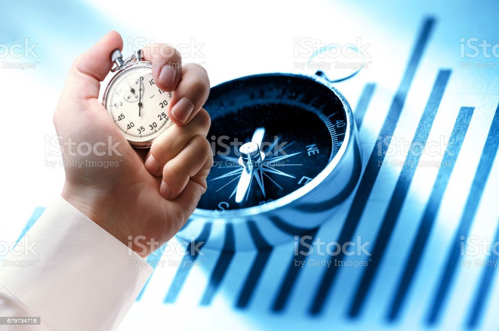 Diagram concept with compass and stopwatch in hand stock photo