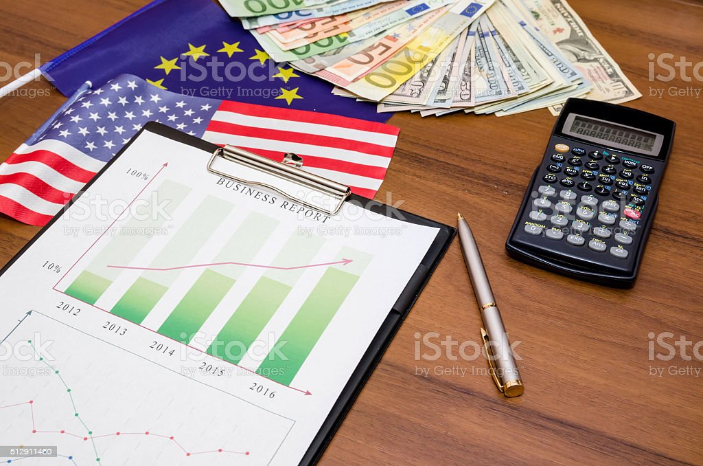 diagram with money, calculator, pen on table stock photo
