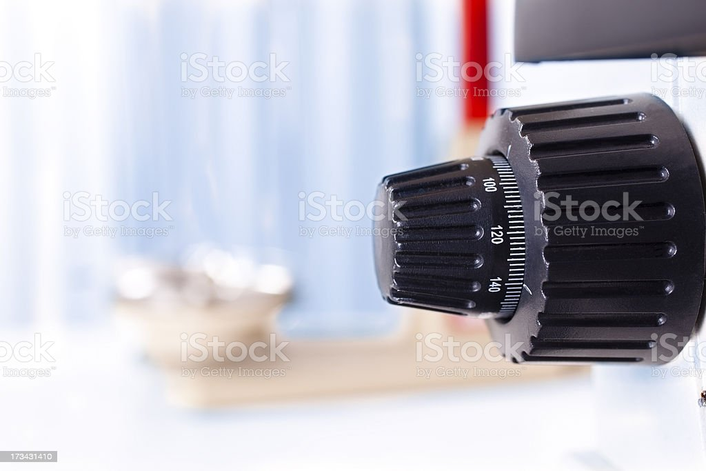 Dial of microscope with measureing scales in background. royalty-free stock photo