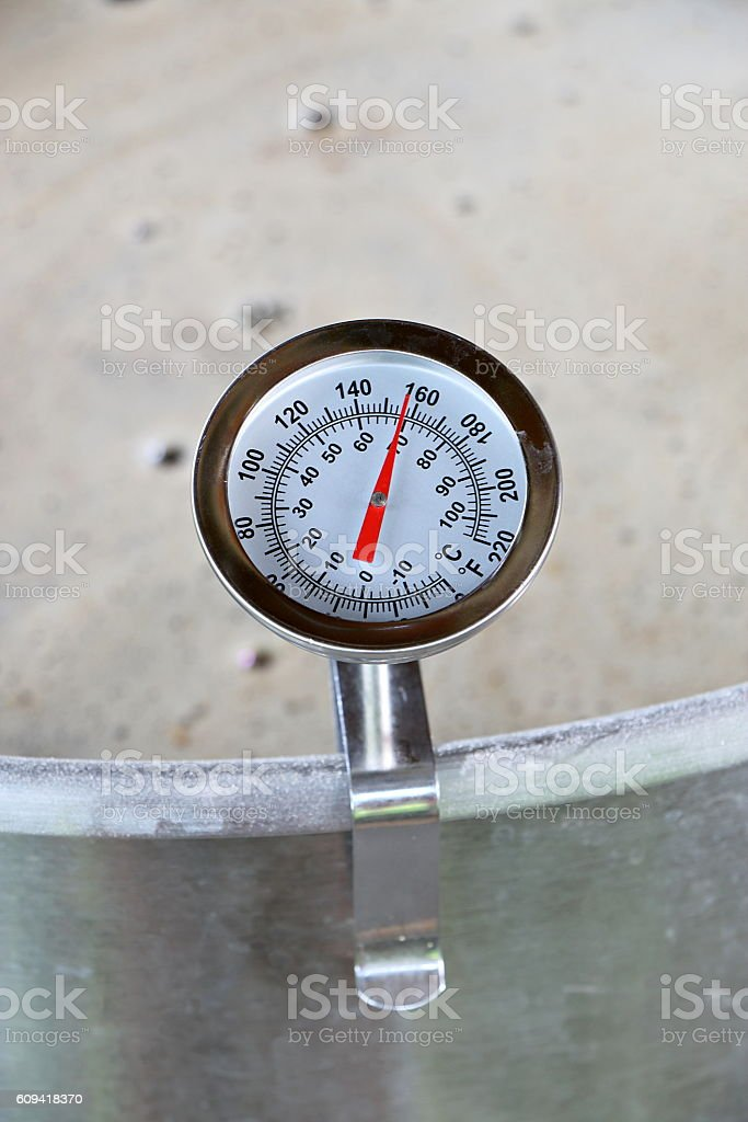 Dial Thermometer in Beer Mash stock photo