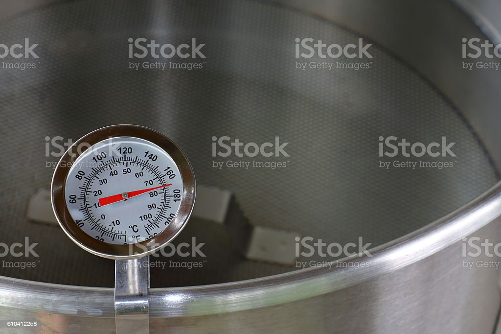 Dial Thermometer in Heating Water stock photo