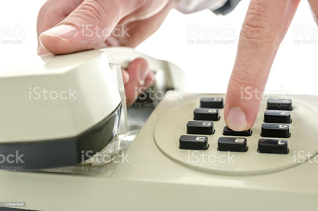 Dialing a number on an old telephone stock photo