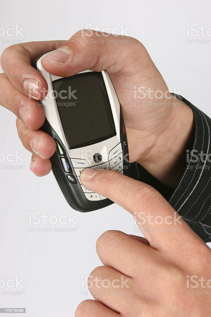 Dialing on a cellular phone stock photo