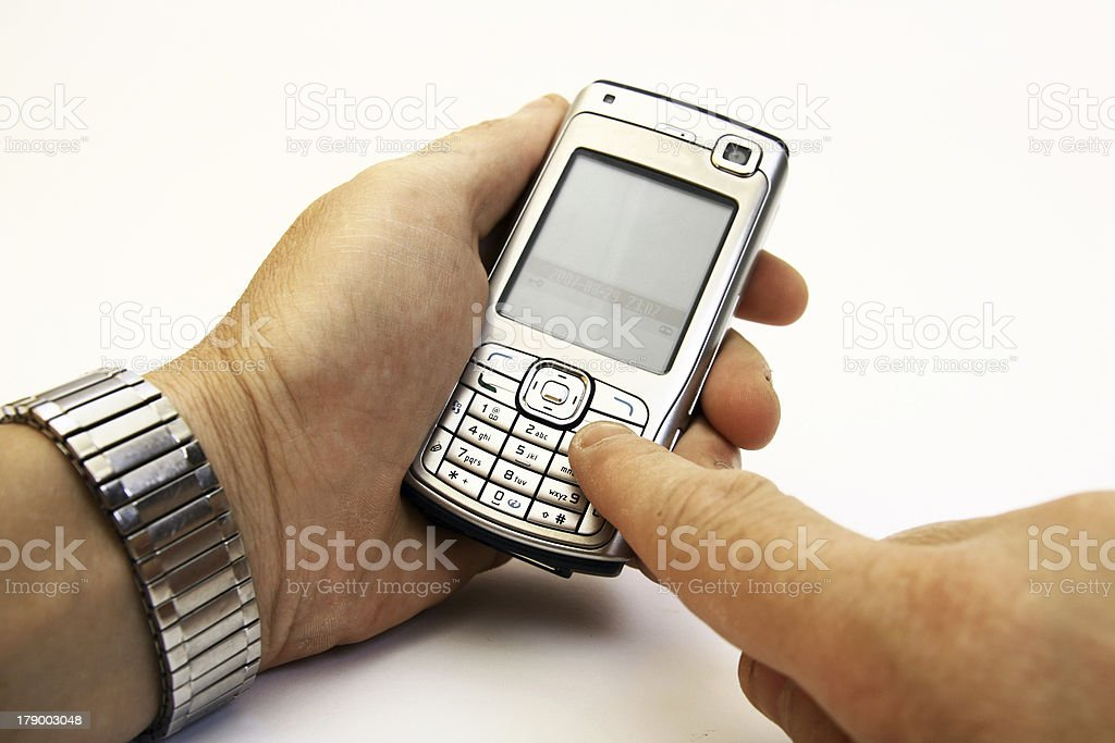 Dialing on a cellular phone royalty-free stock photo