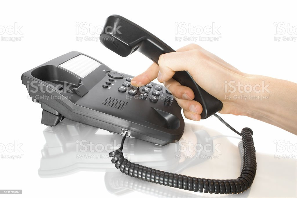 dialing on telephone royalty-free stock photo