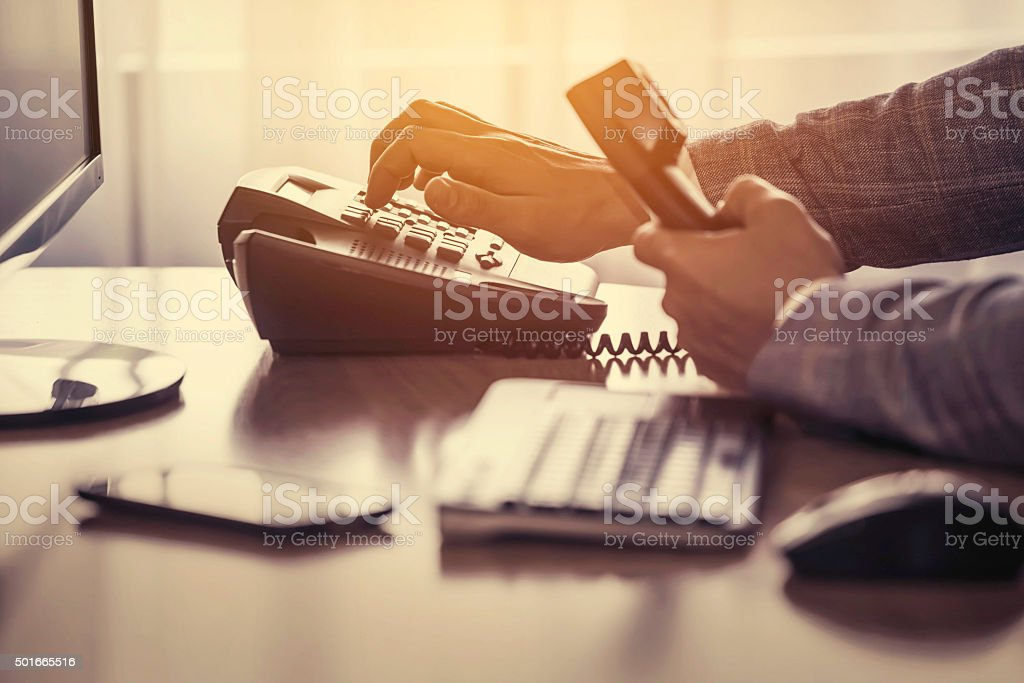 Dialing phone stock photo