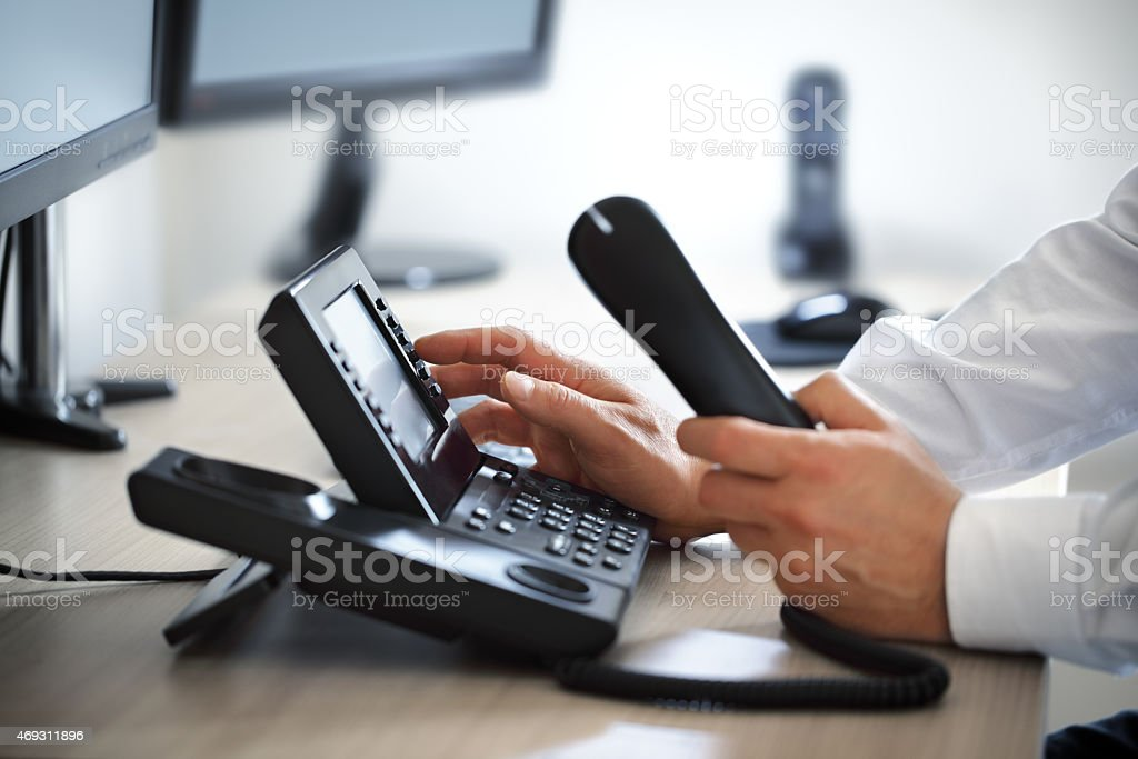 Dialing telephone keypad stock photo