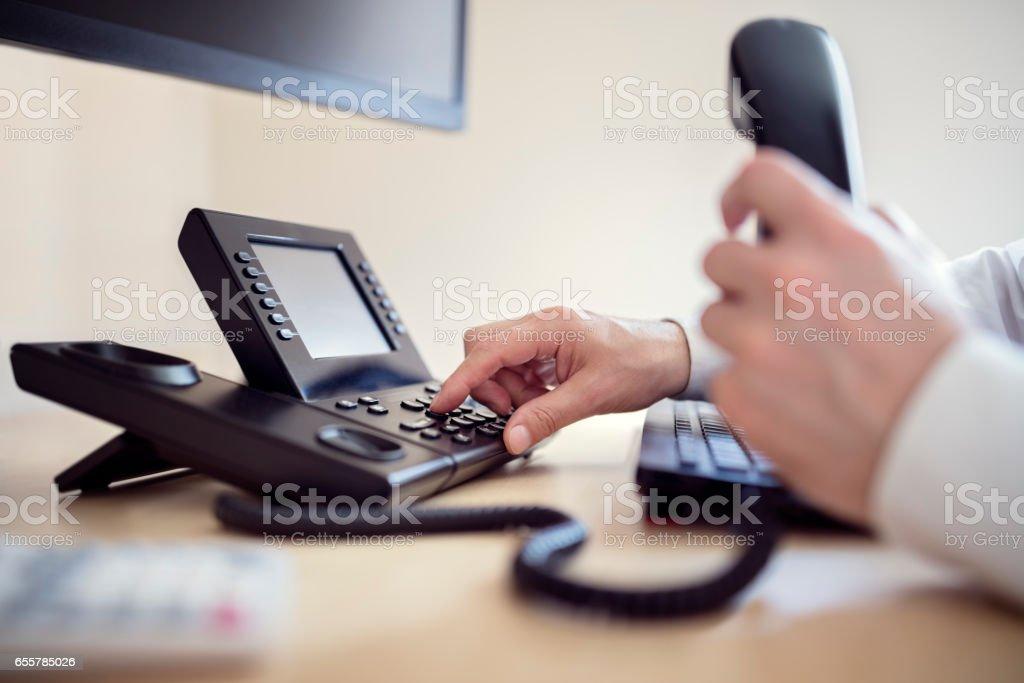 Dialing telephone keypad stock photo