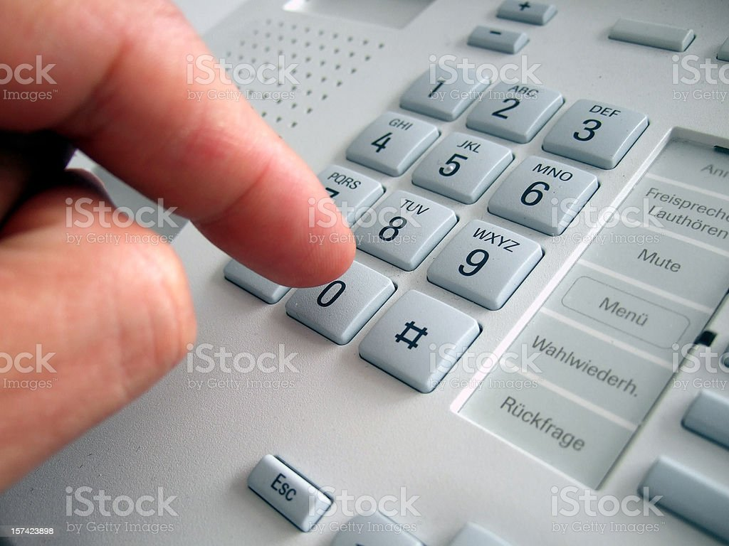 dialing telephone number stock photo