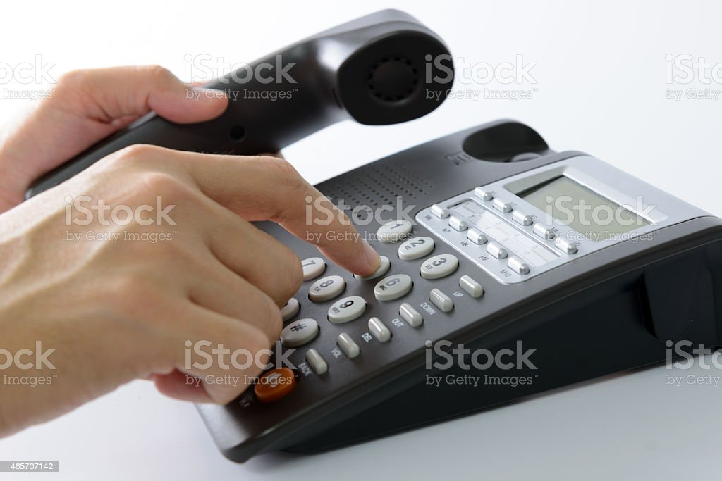 Dialing telephone stock photo