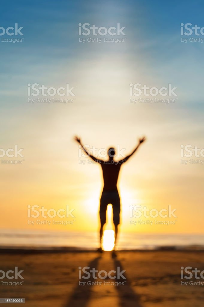 Dialog with heaven. Defocused man phantom silhouette in sunbeam stock photo