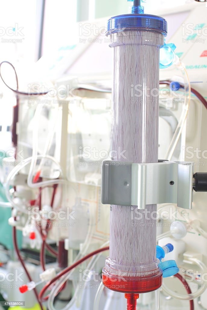 dialysis filter on the background of complex medical equipment stock photo