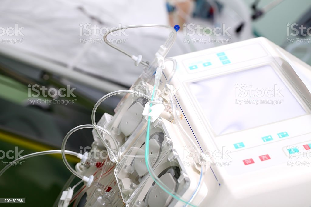 Dialysis machine in hospital ward on critically ill patinent's background stock photo