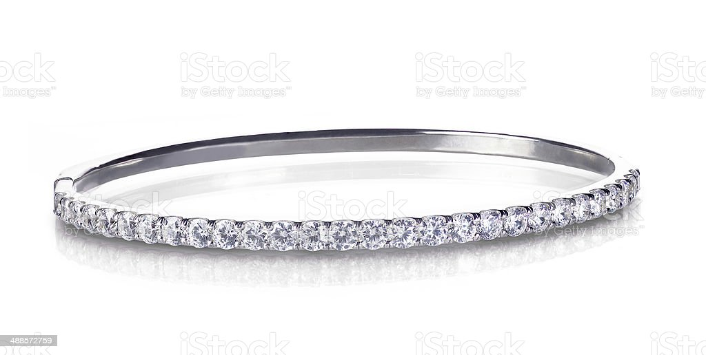 Diamond and gold bangle bracelet stock photo